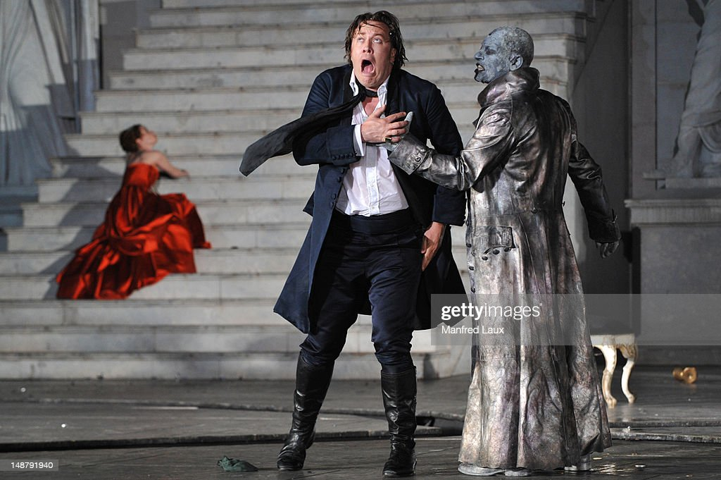 Birgit Minichmayr (Beauty), Nicholas Ofczarek (Everyman) and Ben Becker (Death) is seen during the photo rehearsal of 'Jedermann' (Everyman) on the Domplatz ahead of Salzburg Festival 2012 on July 19, 2012 in Salzburg, Austria. The Salzburg Festival 2012 will run from July 20th til September 2nd 2012. (Photo by Manfred Laux/Getty Images)til September 2nd 2012.