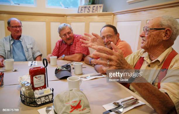 From left Bob Wiser Bill Woolen and Mark Zivan listen as Roger Putman shares a story while having breakfast at the Fairway Restaurant and Pizzeria in...