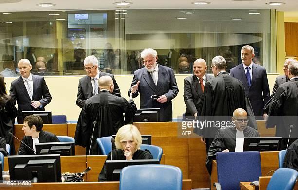 Bosnian Croats Jadranko Prlic Bruno Stojic Slobodan Praljak Milivoj Petkovic Valentin Coric and Berislav Pusic stand in the courtroom on May 29 2013...