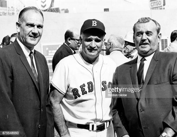 From left Boston Red Sox alumni Dave 'Boo' Ferris Bobby Doerr and Jack 'Black Jack' Wilson pose together at Fenway Park in Boston on the opening day...