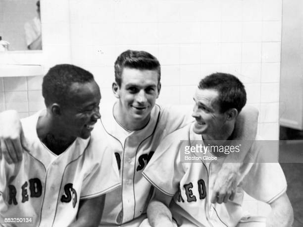 From left Boston Red Sox Pumpsie Green Don Schwall and Gary Geiger sit in the locker room at Fenway Park July 23 1961