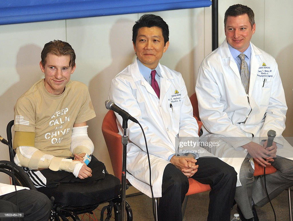 From left, Brendan Marrocco, Dr. W.P. Andrew Lee, Dr. Jamie Shores, and Brendan Marrocco attend a press conference, January 29, 2013, held at Johns Hopkins Hospital in Baltimore, Maryland, with his team of doctors to discuss his bilateral arm transplant surgery, which was done on Dec. 18, 2012. Marrocco lost all four limbs in a roadside bomb attack in Iraq in 2009. Marrocco, from Staten Island, New York, is the first successful double arm transplant at Hopkins, and only the 7th patient in the U.S. to undergo this surgery.