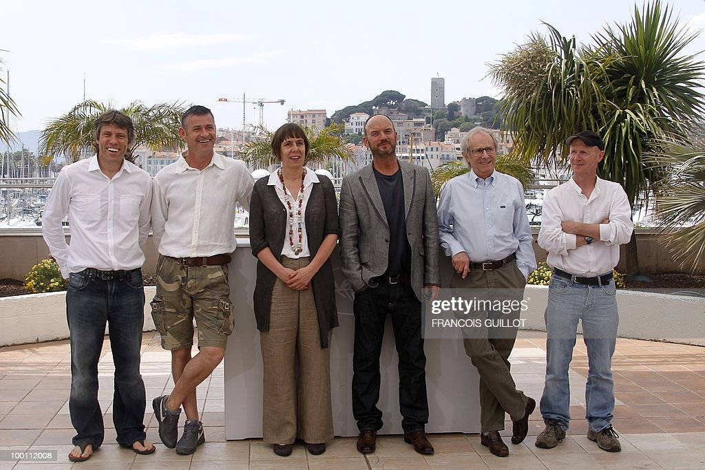 British actors John Bishop, Trevor Williams, producer Rebecca O'Brien, actor Mark Womack, director Ken Loach and screenwriter Paul Laverty pose during the photocall 'Route Irish' presented in competition at the 63rd Cannes Film Festival on May 21, 2010 in Cannes.