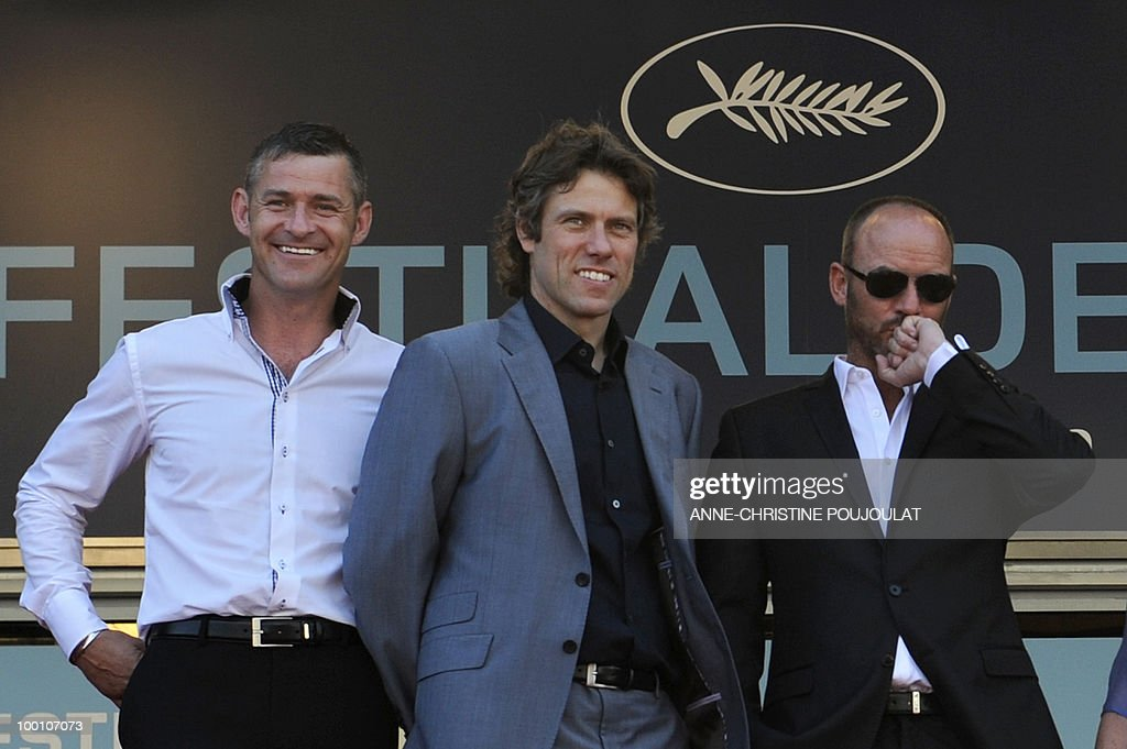 British actors Trevor Williams, <a gi-track='captionPersonalityLinkClicked' href=/galleries/search?phrase=John+Bishop+-+Actor&family=editorial&specificpeople=7360807 ng-click='$event.stopPropagation()'>John Bishop</a> and Mark Womack arrive for the screening of 'Route Irish' presented in competition at the 63rd Cannes Film Festival on May 20, 2010 in Cannes.