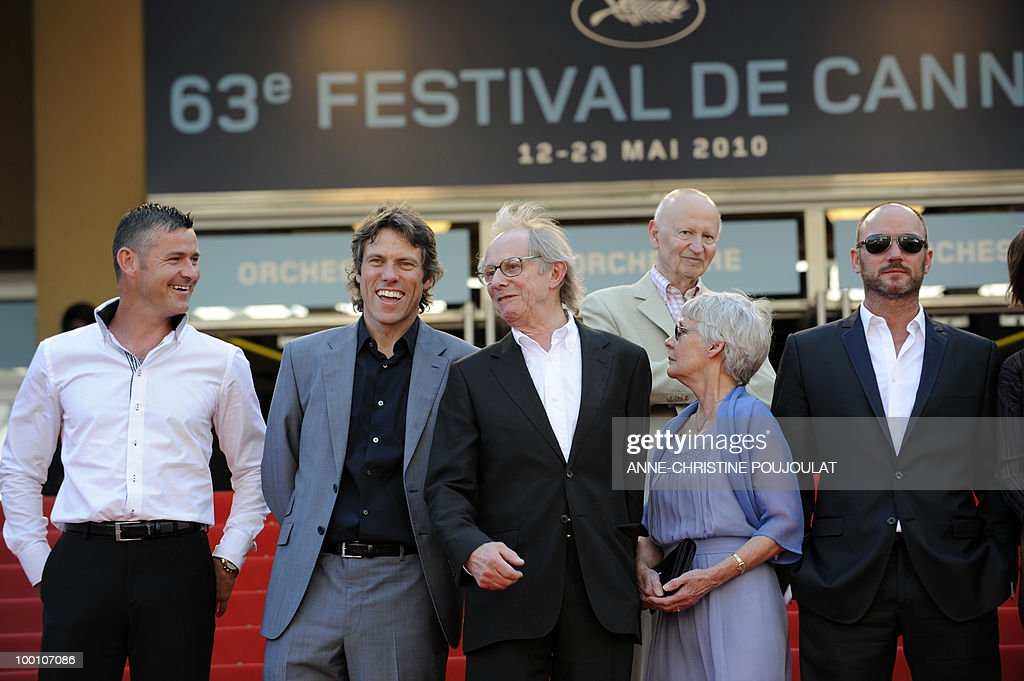 British actors Trevor Williams, John Bishop, British director Ken Loach and his wife Lesley Ashton and British actor Mark Womack arrive for the screening of 'Route Irish' presented in competition at the 63rd Cannes Film Festival as Cannes Film Festival President Gilles Jacob (top) looks on, on May 20, 2010 in Cannes.