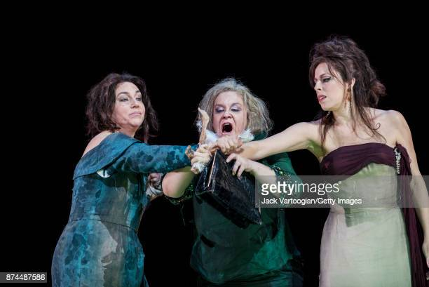 From left British mezzosopranos Christine Rice and Alice Coote and American soprano Audrey Luna perform at the final dress rehearsal prior to the US...