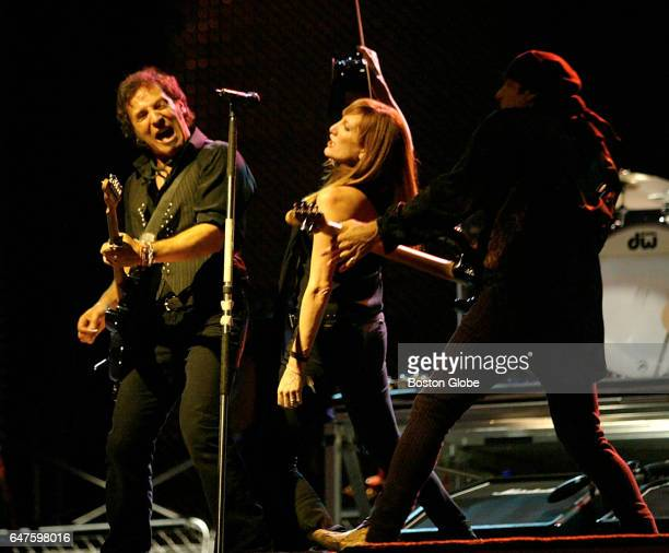 From left Bruce Springsteen Patty Scialfa and Steven Van Zandt perform at Fenway Park in Boston on Sep 6 2003