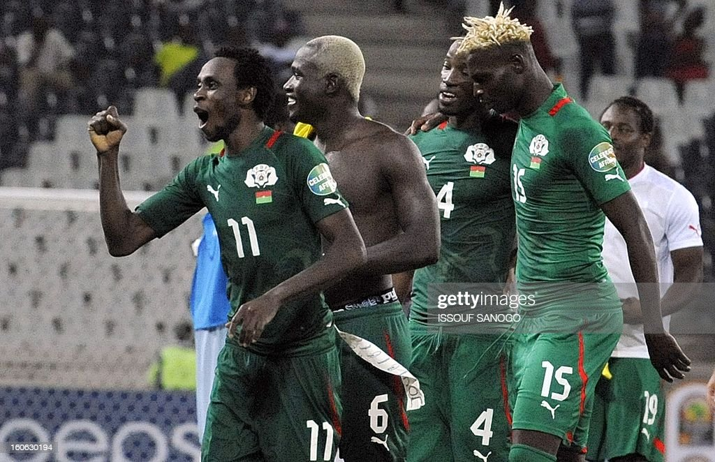 Burkina Faso players Jonathan Pitroipa, Djakaridja Kone, Bakary Bone and Aristide Bance celebrate on February 3, 2013 after an African Cup of Nations quarter-finals football match against Togo in Nelspruit. SANOGO