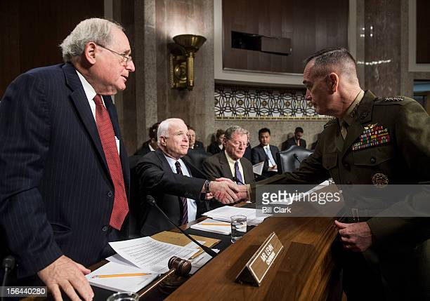 From left Chairman Carl Levin DMich and ranking member John McCain RAriz greet Marine Corps Gen Joseph Dunford Jr before the start of the Senate...