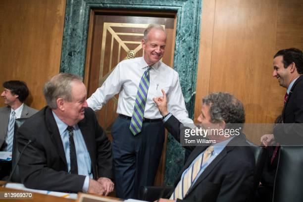 From left Chairman Mike Crapo RIdaho Sen Jerry Moran RKan Ranking Member Sherrod Brown DOhio and Sen Brian Schatz DHawaii prepare for a Senate...