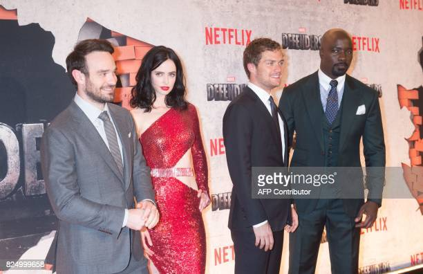 Charlie Cox Krysten Ritter Finn Jones and Mike Colter arrive for the Netflix premiere of Marvel's 'The Defenders' on July 31 2017 in New York / AFP...