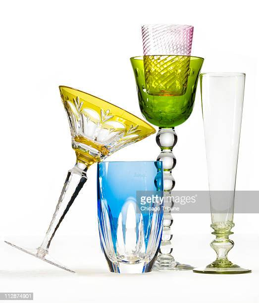 Choose from a Faberge yellowcut martini glass $400 for a set of four in various colors and Faberge bluecut whiskey glass $350 for a set of four in...
