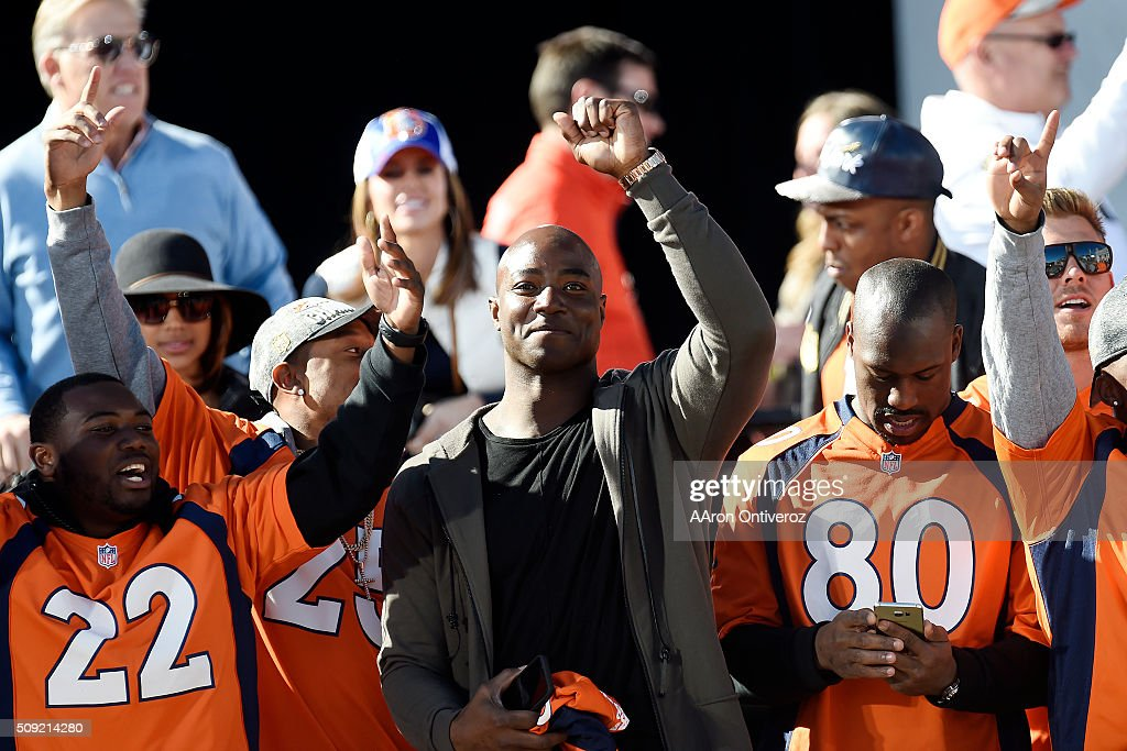 From left CJ Anderson, Chris Harris Jr., Demarcus Ware and Vernon Davis celebrate on the stage at the City and County Building during the Denver Broncos Super Bowl championship celebration and parade on Tuesday February 9, 2016.