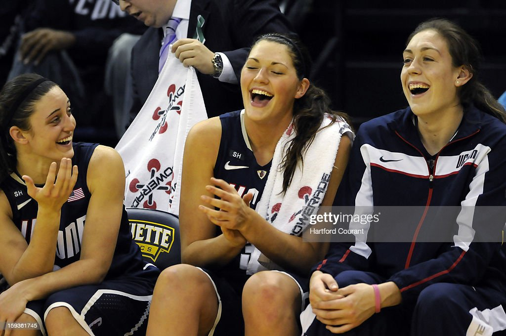 From left, Connecticut's Kelly Faris, Stefanie Dolson and Breanna Stewart share a laugh late in an 85-51 win against Marquette at the Al McGuire Center in Milwaukee, Wisconsin, on Saturday, January 12, 2013.
