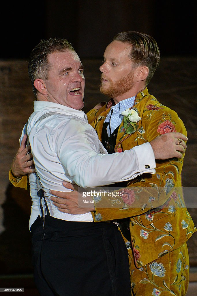 From left Cornelius Obonya (Everyman) and Patrick Gueldenberg (Fellowship) are seen during the photo rehearsal of 'Jedermann' (Everyman) on the Domplatz ahead of Salzburg Festival 2014 on July 16, 2014 in Salzburg, Austria.