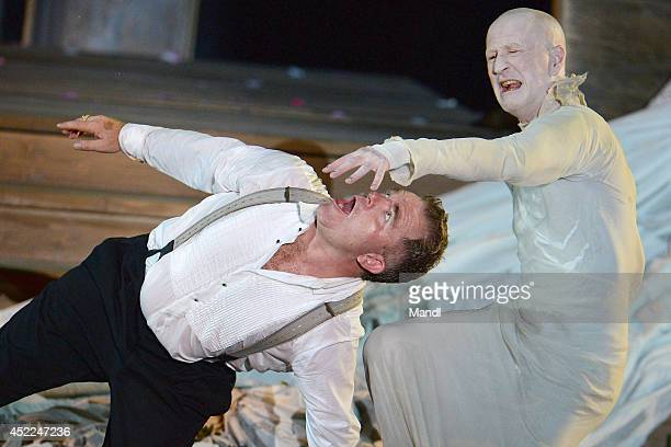 From left Cornelius Obonya and Peter Lohmeyer are seen during the photo rehearsal of 'Jedermann' on the Domplatz ahead of Salzburg Festival 2014 on...