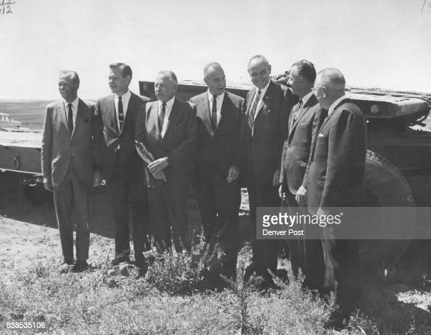 From left County Commissioners Howard E Abbott John J Nicholl and John V Christensen Harold Stillman Western Paving and Construction Co H T Kimball...