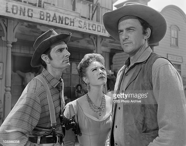 GUNSMOKE From left Dennis Weaver as Chester Goode Amanda Blake as Kitty Russell and James Arness as Marshal Matt Dillon in 'The Thoroughbreds' Image...