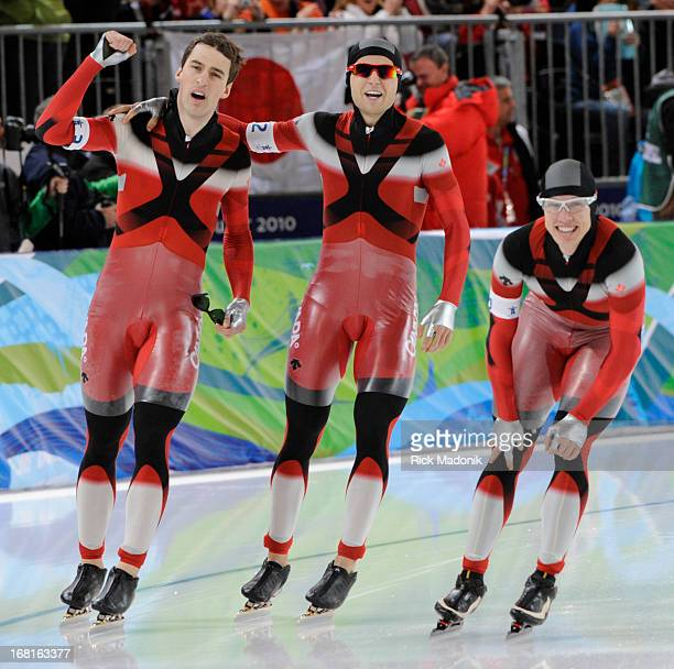 From left Denny Morrison Lucas Makowsy and Mathieu Giroux celebrate their GOLD in Men's Team Pursuit in Long Track skating at Richmond Oval