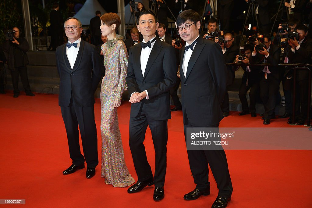Director from Hong-Kong Johnnie To, Chinese actress Sammi Cheng, actor Andy Lau and actor Wai Ka-Fai pose on the red carpet on May 19, 2013 before the screening of their movie 'Blind Detective' presented out of Competition at the 66th edition of the Cannes Film Festival in Cannes. AFP PHOTO / ALBERTO PIZZOLI