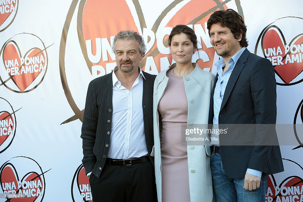 From left, director Giovanni Veronesi, actress <a gi-track='captionPersonalityLinkClicked' href=/galleries/search?phrase=Laetitia+Casta&family=editorial&specificpeople=203075 ng-click='$event.stopPropagation()'>Laetitia Casta</a> and actor Fabio De Luigi attend 'Una Donna per Amica' photocall at Moderno Cinama on February 24, 2014 in Rome, Italy.