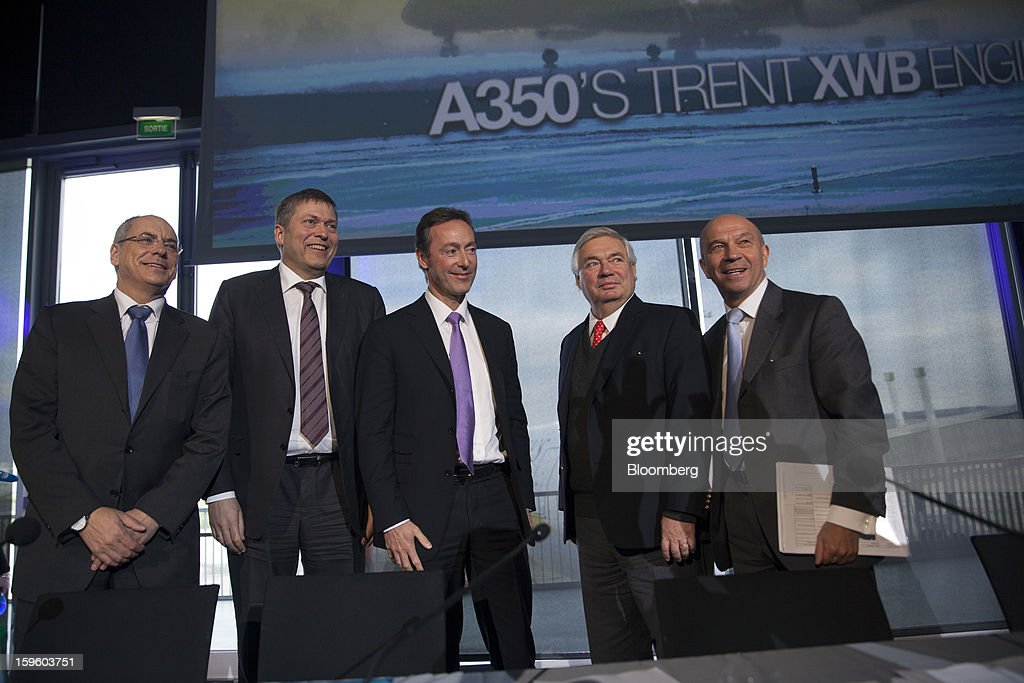 From left, Domingo Urena-Raso, chief executive officer of Airbus Military, Guenter Butschek, chief operating officer of Airbus SAS, Fabrice Bregier, chief executive officer of Airbus SAS, John Leahy, chief operating officer of Airbus SAS, and Tom Williams, vice president of programs for Airbus SAS, pose for a photograph during a news conference in Colomiers, France, on Thursday, Jan. 17, 2013. Airbus SAS Chief Executive Officer Fabrice Bregier said he's sticking with a goal of flying the A350 jet mid-year and that it represents 'a lower risk approach' than the Boeing Co. 787 grounded by U.S. regulators yesterday. Photographer: Balint Porneczi/Bloomberg via Getty Images
