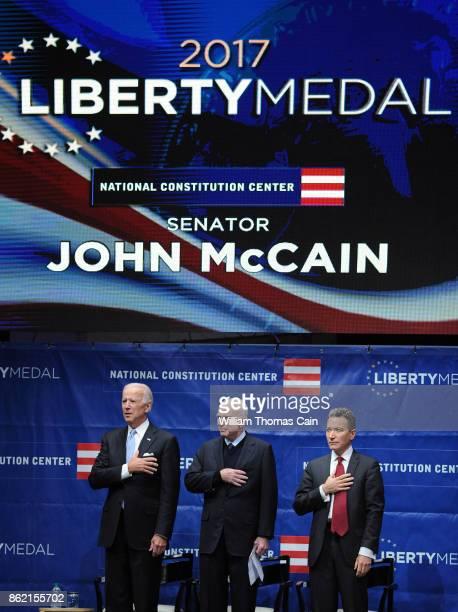 From left during the National Anthem former Vice President Joe Biden Sen John McCain and National Constitution Center President and CEO Jeffrey Rosen...