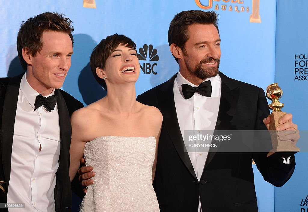 Eddie Redmayne, Anne Hathaway and Hugh Jackman pose with the best motion picture comedy or musical award for 'Les Miserables' in the press room at the Golden Globes awards ceremony in Beverly Hills on January 13, 2013. AFP PHOTO/Robyn BECK