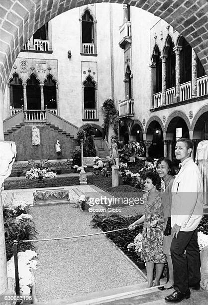 From left Edna Russo Evan Jordan and Rollins Ross stand in the courtyard of the Isabella Stewart Gardner Museum in Boston on May 6 during a special...