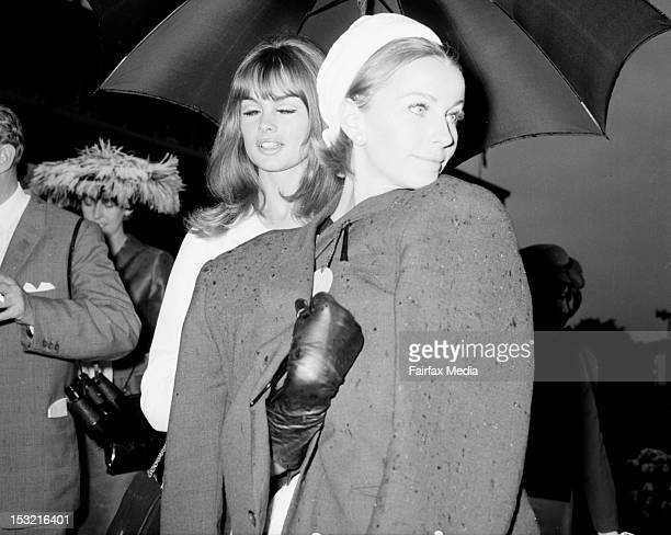 From left English model Jean Shrimpton and French model Christine Borge at Flemington Racecourse in Melbourne for Oaks Day November 4 1965