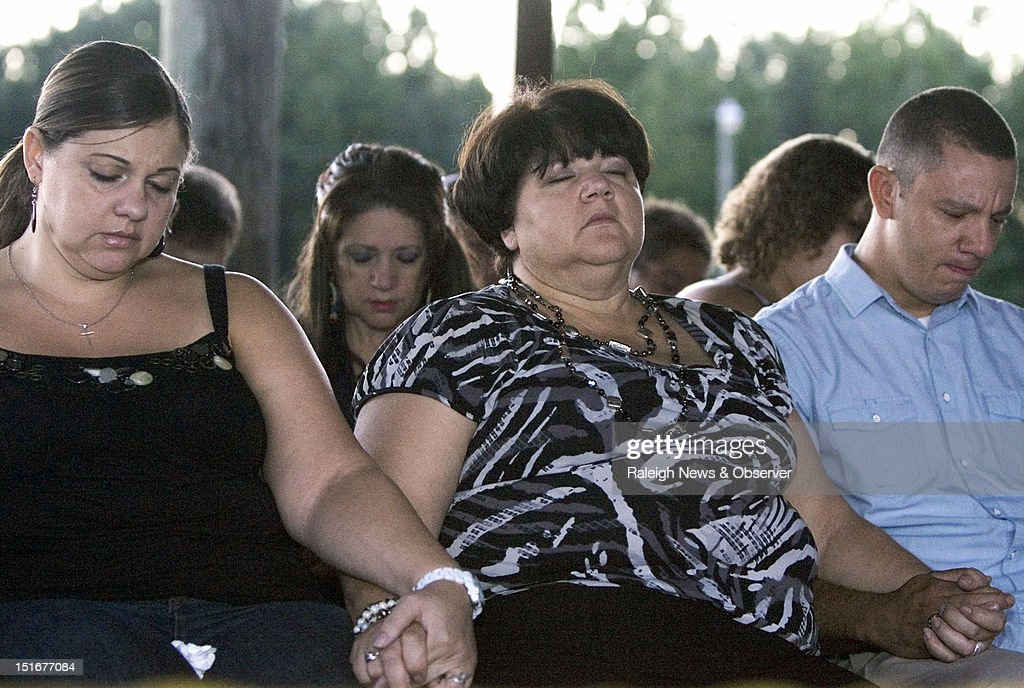 From left, Faith's sister Rolanda Hedgepeth, mother Connie Hedgepeth and cousin Jonathan Hedgepeth join other family, friends and community members at a candlelight vigil at the Haliwa-Saponi Tribal School in Hollister, North Carolina, to remember and pray for Faith Hedgepeth. A member of the Haliwa-Saponi American Indian Tribe, Hedgepeth was found dead in her Chapel Hill apartment on Friday. She was a sophomore, Biology major at UNC-Chapel Hill.