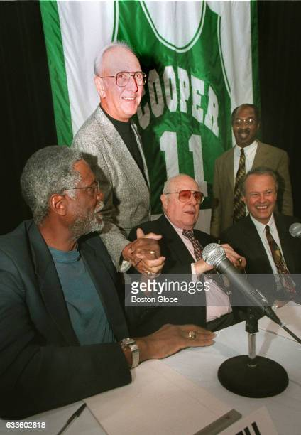 From left Former Celtics players Bill Russell and Bob Cousey Celtics president Red Auerbach Charles Ogletree and Richard Lapchick are pictured on the...
