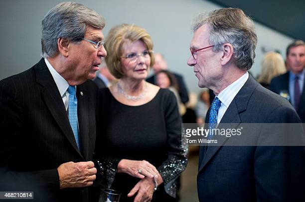 From left former Sen Trent Lott RMiss his wife Tricia and former Sen Tom Daschle DSD talk during a gala that was part of the dedication ceremony for...