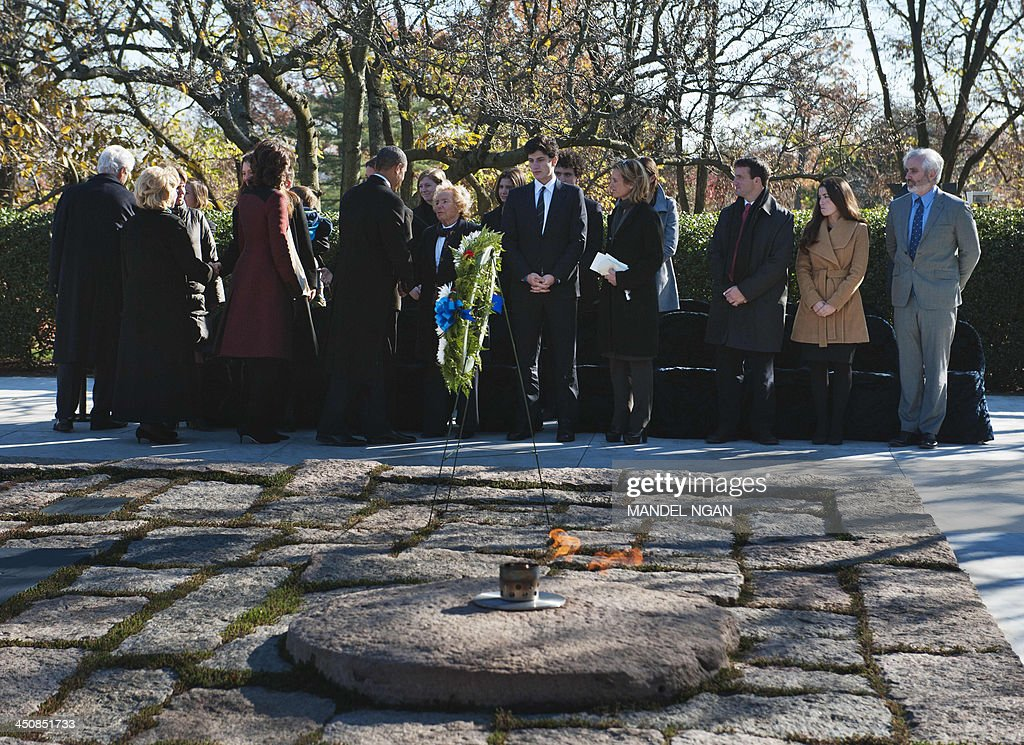 former US President Bill Clinton, former Secretary of State Hillary Clinton, First Lady Michelle Obama, and US President Barack Obama greet Kennedy family members behind the John F. Kennedy eternal flame after they took part in a wreath-laying ceremony in honor of the late President John F. Kennedy at Arlington National Cemetery on November 20, 2013 in Arlington, Virginia. AFP PHOTO/Mandel NGAN