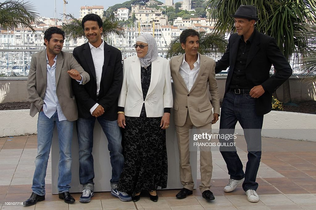French actor Jamel Debbouze, French actor Sami Bouajila, actress Chafia Boudraa, French director Rachid Bouchareb and French actor Roschdy Zem during the photocall of 'Hors La Loi' (Outside of the Law) presented in competition at the 63rd Cannes Film Festival on May 21, 2010 in Cannes.