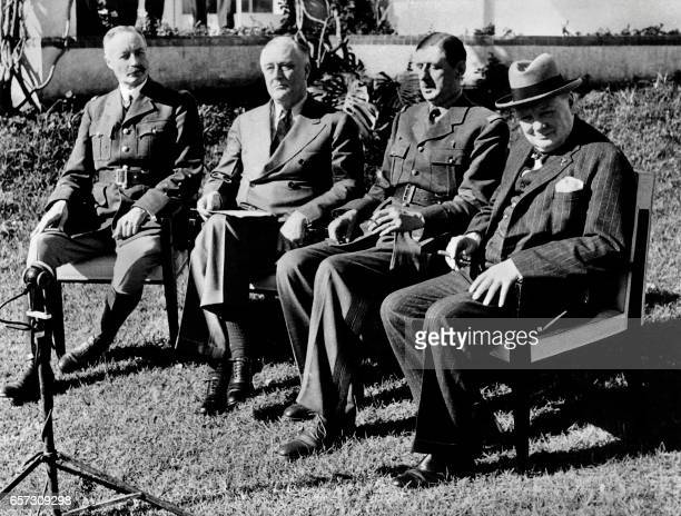 From left French General Henri Giraud US President Franklin Roosevelt General Charles de Gaulle the chief of French Free forces and British Prime...