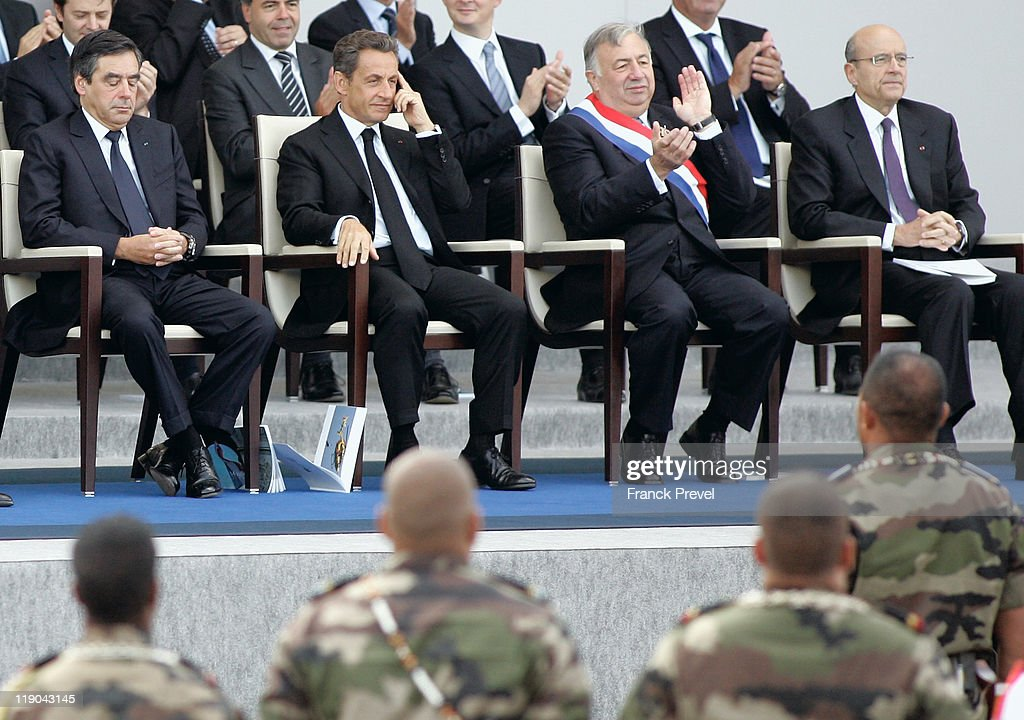 French Prime Minister Francois Fillon, French President Nicolas Sarkozy, French President of the Senate Gerard Larcher and Foreign Affairs Minister Alain Juppe attend the annual Bastille day parade on the Place de la Concorde on July 14, 2011 in Paris, France. The French National Day celebrates its revolution in the1789 through various parades in the storming of the Bastille in 1789 through various parades and official ceremonies throughout France.