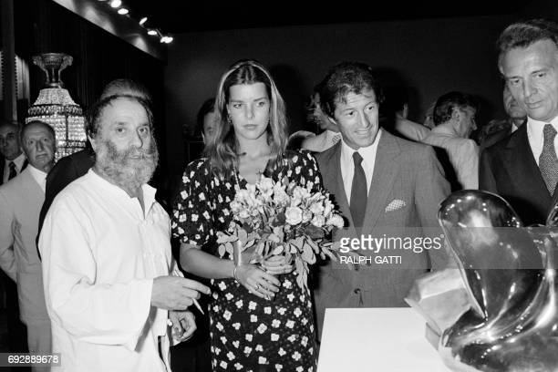 From left French sculptor Cesar Princess Caroline de Monaco and her husband Philippe Junot visit an exhibition stand during the 'Biennale des...