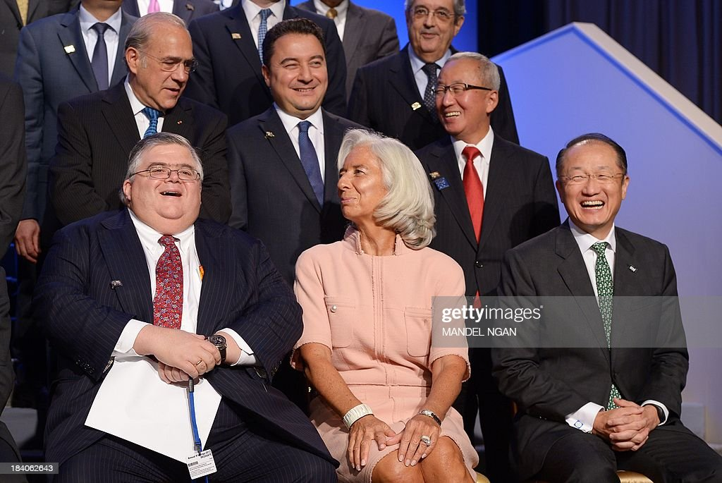 Mexico Central Bank Governor Agustín Carstens (L) laughs with IMF Managing Director Christine Lagarde, and World Bank President Jim Yong Kim before the G-20 Finance Ministers and Central Bank Governors family photograph, during the World Bank/IMF Annual Meetings in the International Monetary Fund Headquarters on October 11, 2013 in Washington, DC. AFP PHOTO/Mandel NGAN