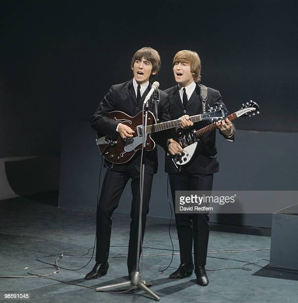 John Lennon playing a Rickenbacker 325 guitar and George Harrison playing Gretsch 6119 Tennessean of The Beatles perform on 'Shindig' television show...