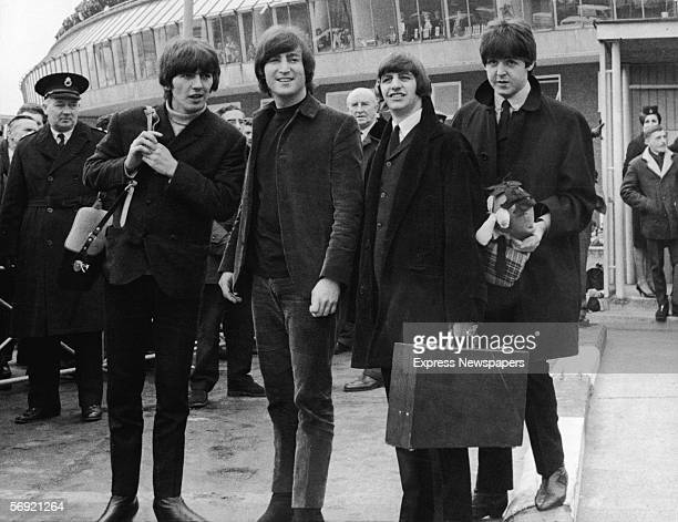 From left George Harrison John Lennon Ringo Starr and Paul McCartney of the British pop group the Beatles pause for photographers outside an...