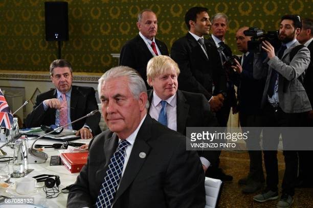 German Foreign Minister Sigmar Gabriel US Secretary of State Rex Tillerson and British Foreign Secretary Boris Johnson sit at a table on the second...