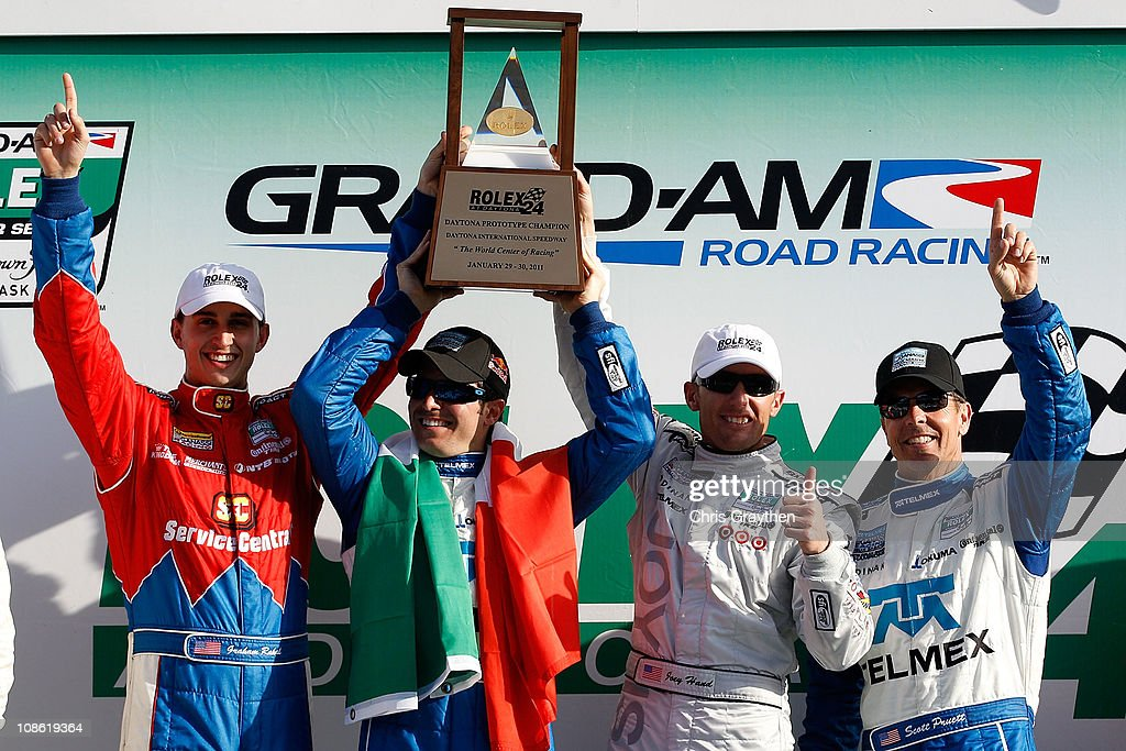 From left, Graham Rahal, <a gi-track='captionPersonalityLinkClicked' href=/galleries/search?phrase=Memo+Rojas&family=editorial&specificpeople=3547976 ng-click='$event.stopPropagation()'>Memo Rojas</a>, Joey Hand and <a gi-track='captionPersonalityLinkClicked' href=/galleries/search?phrase=Scott+Pruett&family=editorial&specificpeople=541449 ng-click='$event.stopPropagation()'>Scott Pruett</a>, drivers of the #01 TELMEX/Target Chip Ganassi Racing with Felix Sabates BMW Riley celebrate after winning the Rolex 24 at Daytona International Speedway on January 30, 2011 in Daytona Beach, Florida.