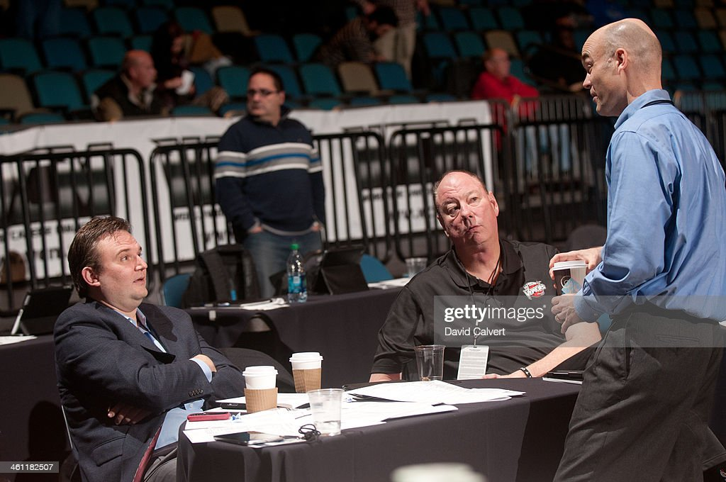 From left, Houston Rockets general manager Daryl Morey talks with Rio Grande Valley Vipers associate head coach Paul Mokeski and Memphis Grizzlies vice president of basketball operations John Hollinger during the 2014 NBA D-League Showcase on January 6, 2014 at the Reno Events Center in Reno, Nevada.