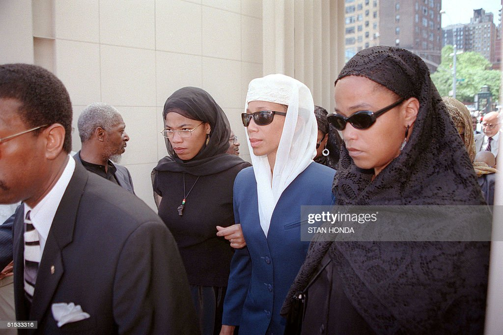Illya, Attallal and Gamilah, three of the daughters of Betty Shabazz enter the Islamic Cultural Center in New York for private funeral service 27 June 1997. Shabazz, the widow of slain African-American leader Malcom X, died 23 June of burns suffered when her flat was set ablaze, allegedly by her grandson Malcom Shabazz.