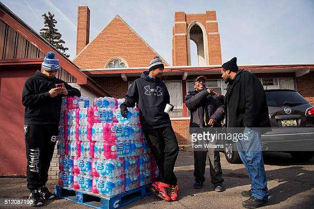 From left Immanuel Stinson Tirrell Mills Walter Simmons and Charles Reid man a water distribution area at the St Mark Baptist Church in Flint Mich...
