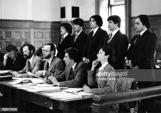 From left in rear row defendants in rape trial Robert Tarr Alexander Aldoupolis John Strickland Mark Savoy and Richard Dovel stand in a Norfolk...