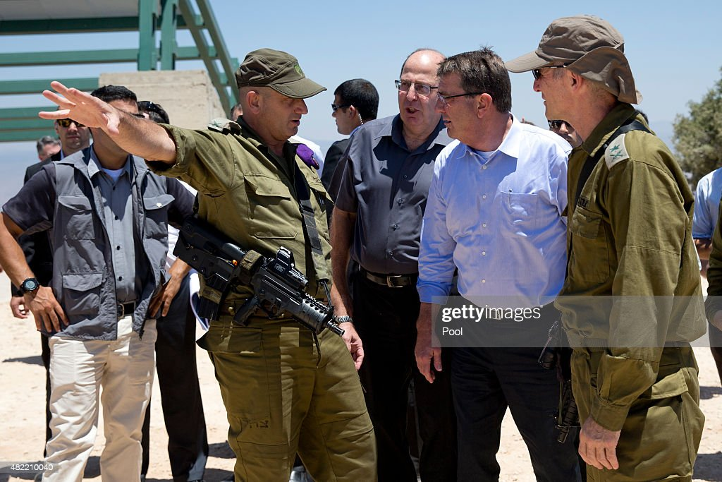 From left Israel Defense Forces 91st Division Commander Moni Katz directing his right arm forward Israeli Defense Minister Moshe Ya'alon US Defense...