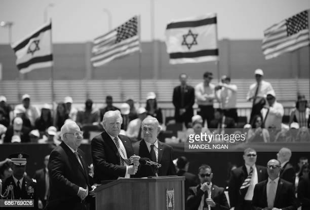 Israel's President Reuven Rivlin US President Donald Trump Israel's Prime Minister Benjamin Benjamin Netanyahu take part in a welcome ceremony upon...