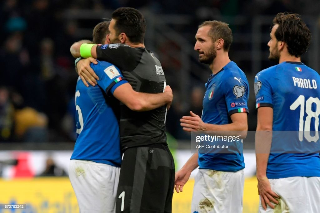Italy's defender Andrea Barzagli, Italy's goalkeeper Gianluigi Buffon, Italy's midfielder Giorgio Chiellini and Italy's midfielder Marco Parolo react at the end of the FIFA World Cup 2018 qualification football match between Italy and Sweden, on November 13, 2017 at the San Siro stadium in Milan. Italy failed to reach the World Cup for the first time since 1958 on Monday as they were held to a 0-0 draw in the second leg of their play-off at the San Siro by Sweden, who qualified with a 1-0 aggregate victory. / AFP PHOTO / Miguel MEDINA